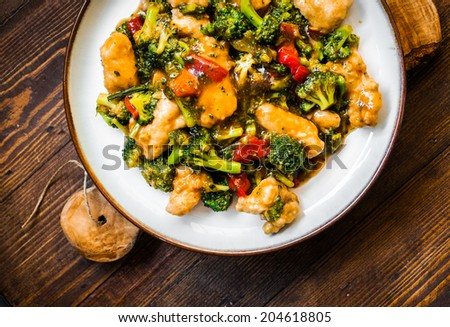 Chicken breasts in soy sauce and stir-fry vegetables - stock photo