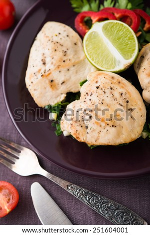 Chicken breasts with parsley and citrus close up. Healthy food. - stock photo