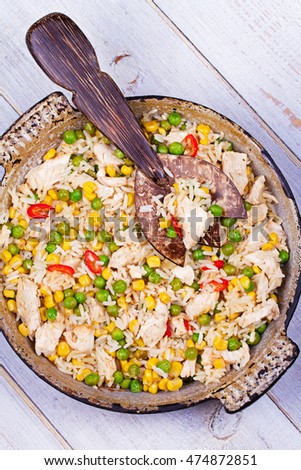 Chicken Breasts with Rice, Peas, Corn and Chili. View from above, top studio shot