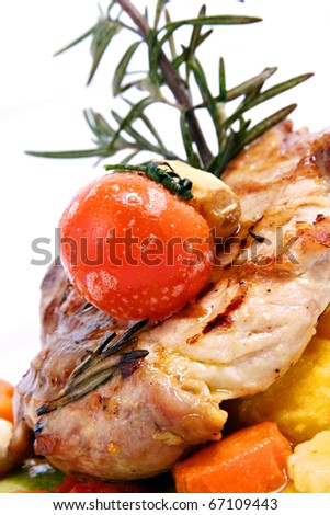 chicken breasts with rosemary and cherry tomato - stock photo