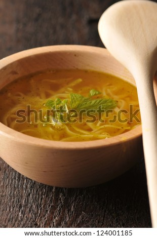 Chicken broth - chicken soup with noodles - stock photo