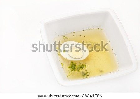 Chicken broth with dill and egg
