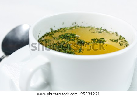 Chicken broth with herbs. Nutrient and tasty first course
