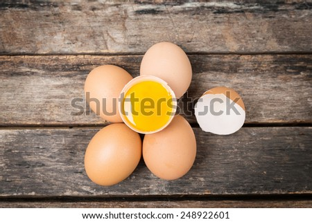 Chicken brown eggs on wooden background. - stock photo