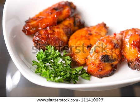 chicken buffalo wings on a plate - stock photo
