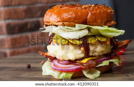 chicken burger with tomato onion cheese lettuce - stock photo