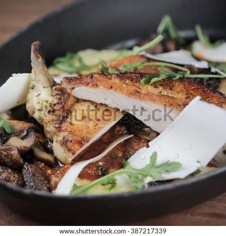 Chicken Cacciatore with pomodoro, cremini mushrooms, polenta, ricotta salata - stock photo