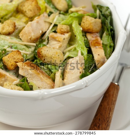 Chicken Caesar Salad with Croutons on white background. Selective focus.