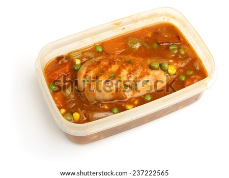 Chicken casserole meal in plastic container ready for chilling or freezing. - stock photo