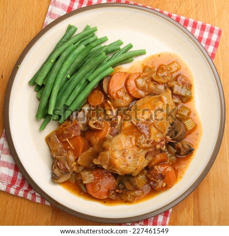 Chicken casserole served with green beans. - stock photo
