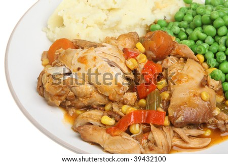 Chicken casserole with mashed potato and peas - stock photo