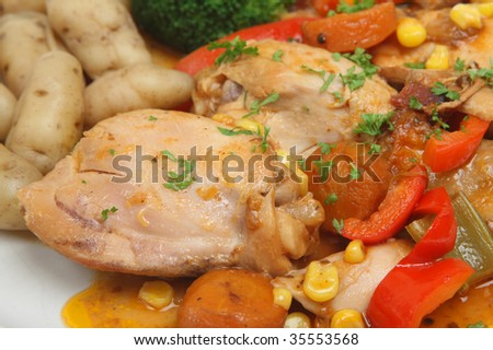 Chicken casserole with new potatoes and vegetables - stock photo