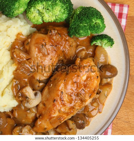 Chicken chasseur, classic French casserole, served with mashed potato and broccoli. - stock photo