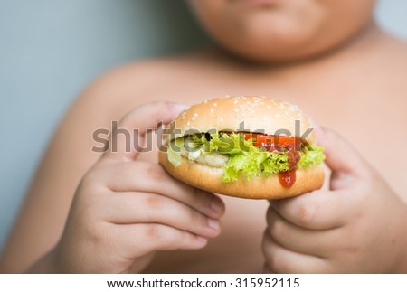 chicken cheese Hamburger in obese fat boy hand - stock photo
