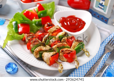 chicken,cherry tomato ,red and grill pepper grilled skewers on plate with ketchup for summer lunch   - stock photo