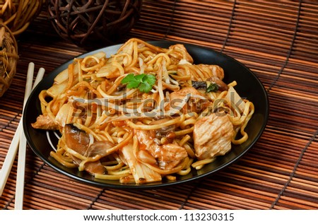 Chicken chow mein a popular chinese food available at take aways - stock photo