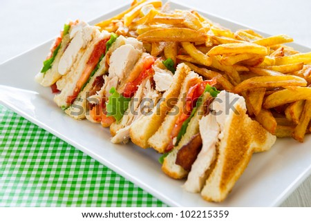 Chicken club sandwich in a white plate. Meal time. - stock photo