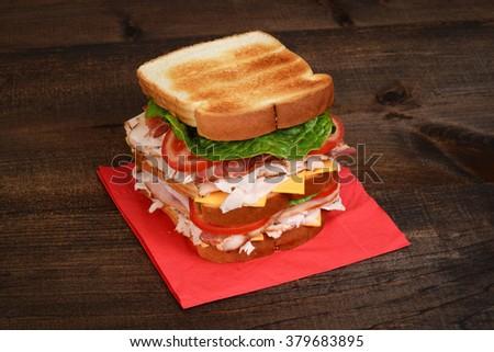 chicken club sandwich on red napkin - stock photo