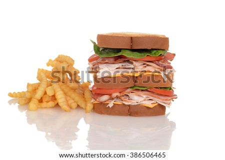 chicken club sandwich with french fries - stock photo