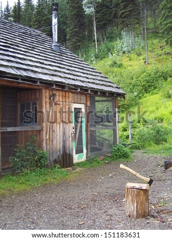 Chicken coop back of cabin - stock photo