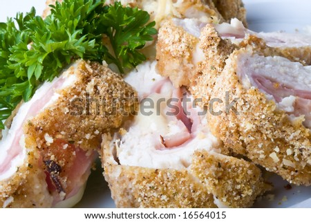 chicken cordon blue on a white plate breaded and close up - stock photo