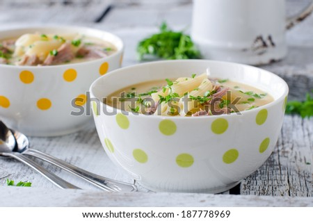 Chicken cream soup with pasta - stock photo