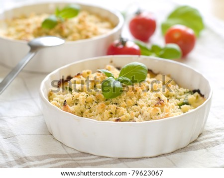 Chicken crumble with tomato on background. Selective focus