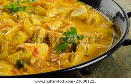 Chicken curry in  bowl on a wooden background. Selective focus - stock photo