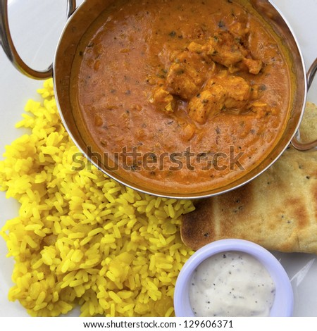 Chicken curry served with rice and naan - stock photo
