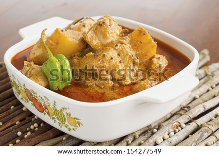 Chicken Curry w Halba Seeds  - stock photo