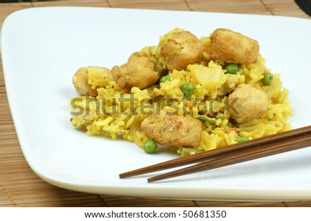 chicken curry with organic rice on a  plate