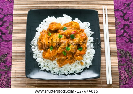 Chicken curry with rice and chopsticks from above - stock photo