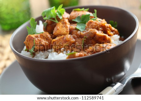 Chicken curry with rice and parsley in a bowl - stock photo