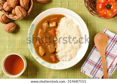 Chicken curry  with rice on a plate with a horizontal top view - stock photo