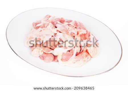 Chicken, cut into pieces on a white background.