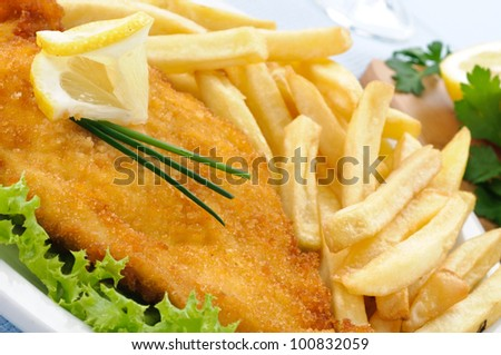 Chicken cutlet with chips, closeup
