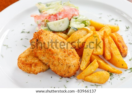 chicken cutlet with fried potatoes