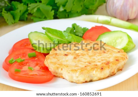 Chicken cutlet with tomatoes and cucumber  - stock photo