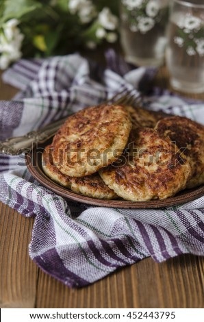 Chicken cutlets with porridge cheese and zucchini