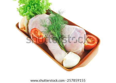 chicken drumstick and green lettuce over white background - stock photo