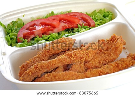 chicken drumstick and vegetable salad - stock photo