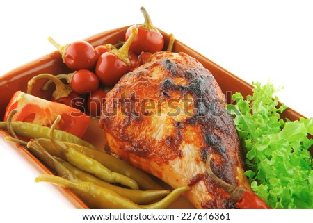 chicken drumstick with tomato and green peppers on white - stock photo