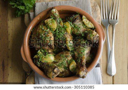 Chicken drumsticks and thighs with Ras el Hanout preserved lemon and apricot  - stock photo