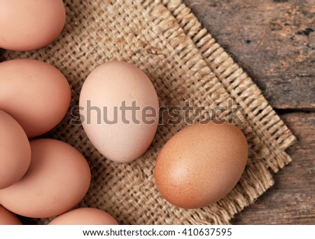 Chicken Egg on wooden rustic background -View from the top.