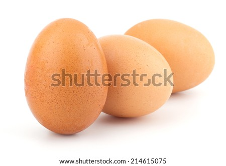 Chicken eggs closeup isolated on white background - stock photo