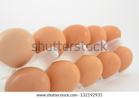 Chicken eggs in a plastic bag on a white background