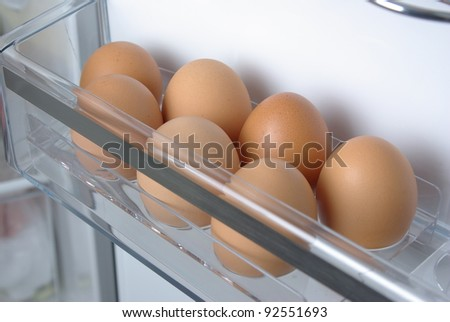 Chicken eggs in the fridge - stock photo