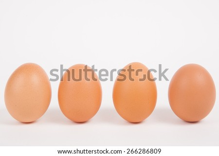 Chicken eggs  on white paper background - stock photo