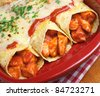 Chicken enchiladas with spicy tomato sauce and cheese. - stock photo