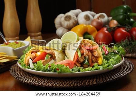 chicken fajita  with guacamole and tortillas - dish of mexico - stock photo
